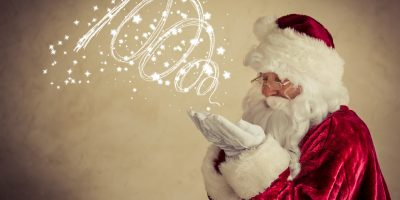 Santa Claus senior man against grunge background. Xmas holiday concept